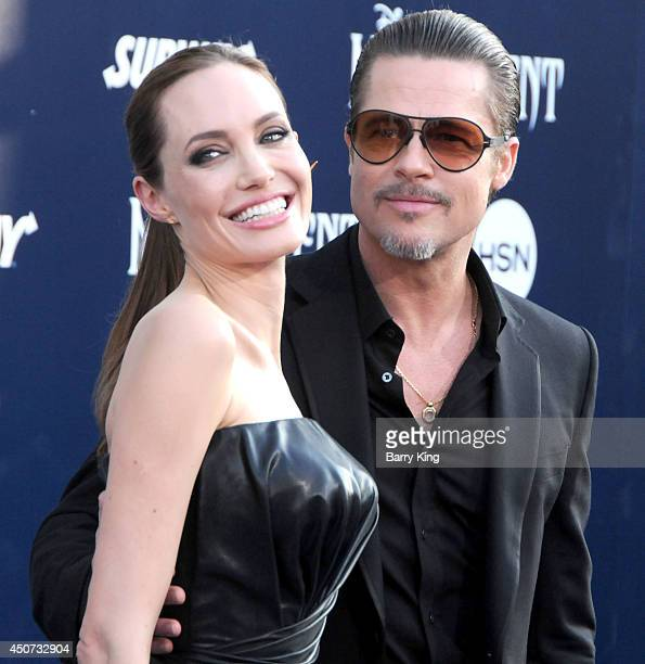 Actress Angelina Jolie and actor Brad Pitt arrive at the Los Angeles premiere of 'Maleficent' on May 28 2014 at the El Capitan Theatre in Hollywood...