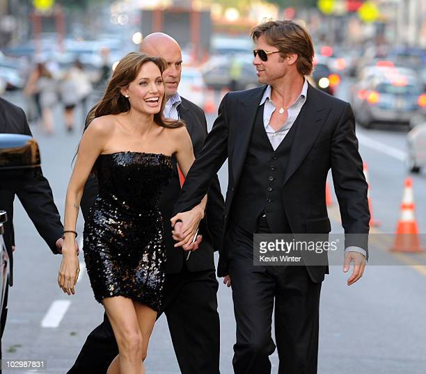 Actress Angelina Jolie and actor Brad Pitt arrive at the premiere of Sony Pictures' 'Salt' at Grauman's Chinese Theatre on July 19 2010 in Hollywood...