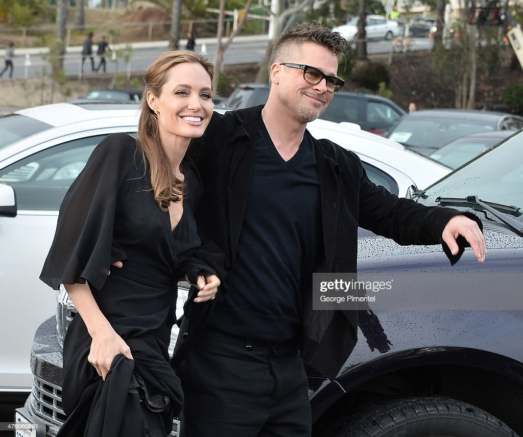 Actress Angelina Jolie (L) and actor Brad Pitt attend the 2014 Film Independent Spirit Awards at Santa Monica Beach on March 1, 2014 in Santa Monica, California.