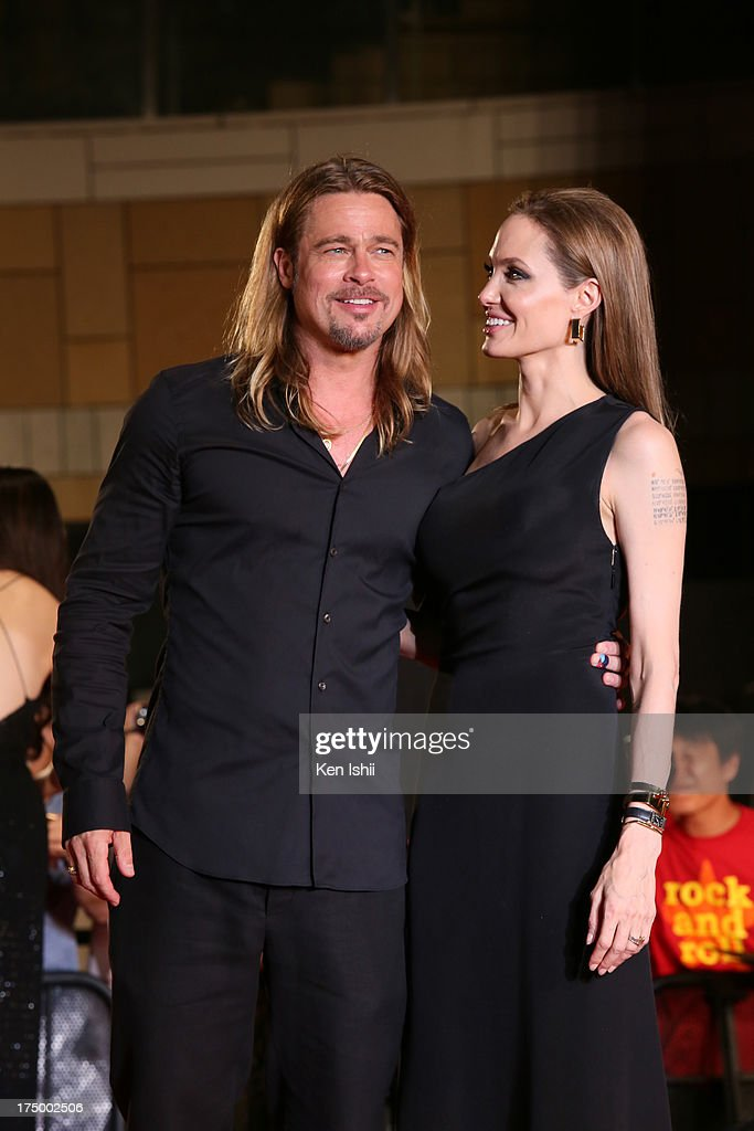Actress <a gi-track='captionPersonalityLinkClicked' href=/galleries/search?phrase=Angelina+Jolie&family=editorial&specificpeople=201591 ng-click='$event.stopPropagation()'>Angelina Jolie</a> and actor <a gi-track='captionPersonalityLinkClicked' href=/galleries/search?phrase=Brad+Pitt+-+Actor&family=editorial&specificpeople=201682 ng-click='$event.stopPropagation()'>Brad Pitt</a> attend the 'World War Z' Japan Premiere at Roppongi Hills on July 29, 2013 in Tokyo, Japan. The film will open on August 10 in Japan.