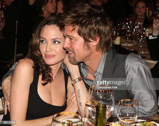 Actress Angelina Jolie and actor Brad Pitt sit together inside at the 13th ANNUAL CRITICS' CHOICE AWARDS at the Santa Monica Civic Auditorium on...