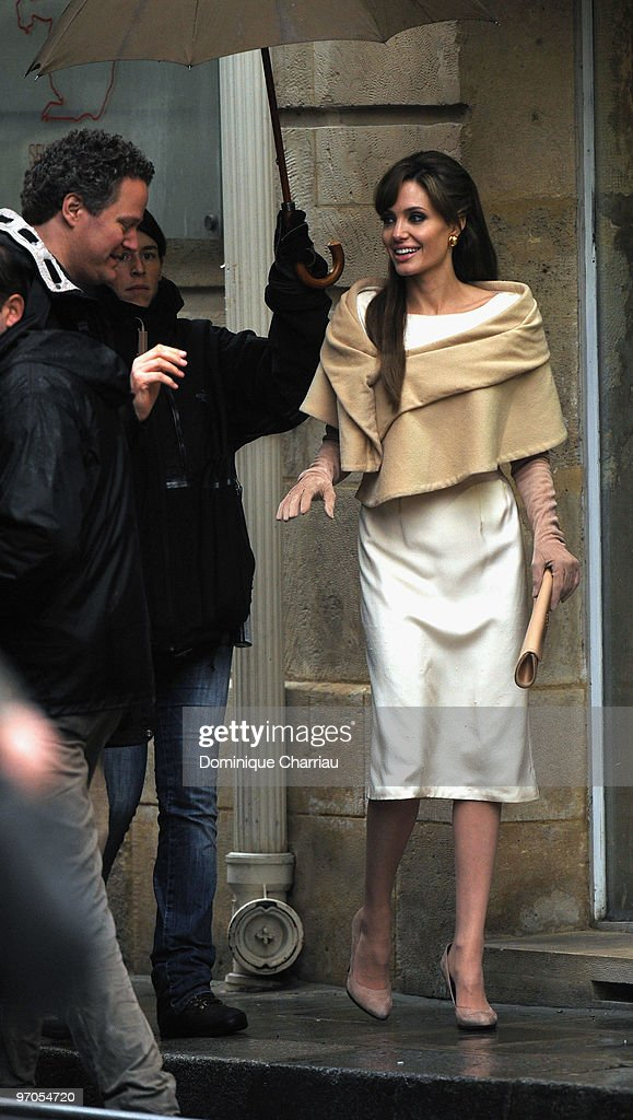 Actress Angelina Jolie(R) and Director Florian Henckel von Donnersmarck films in Place des Victoires of Paris for the Movie 'The Tourist' on February 25, 2010 in Paris, France.