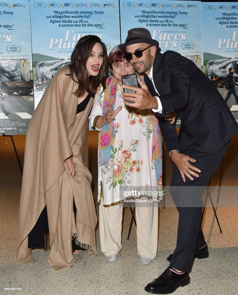 Actress Angelina Jolie, and directors Agnes Varda and JR attend the premiere of Cohen Media Group's 'Faces Places' at the Pacific Design Center on October 11, 2017 in West Hollywood, California.