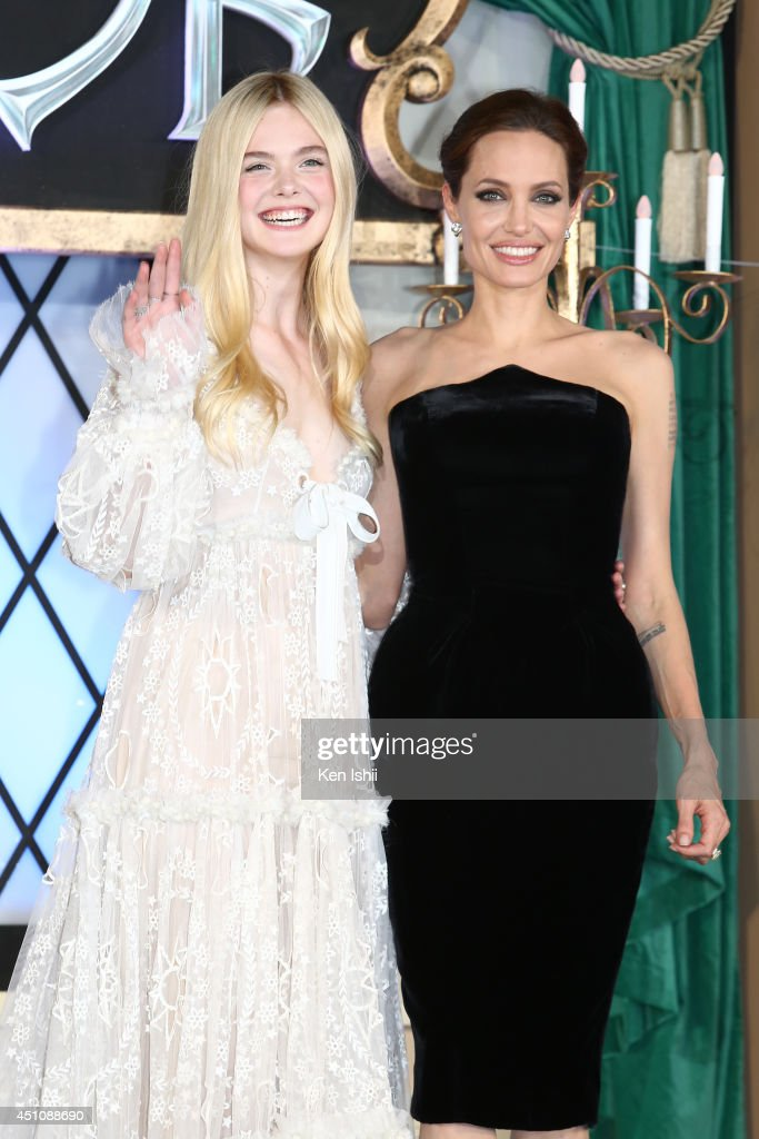 Actress Angelina Jolie (L) and Elle Fanning attend 'Maleficent' Japan premiere at Ebisu Garden Place on June 23, 2014 in Tokyo, Japan.