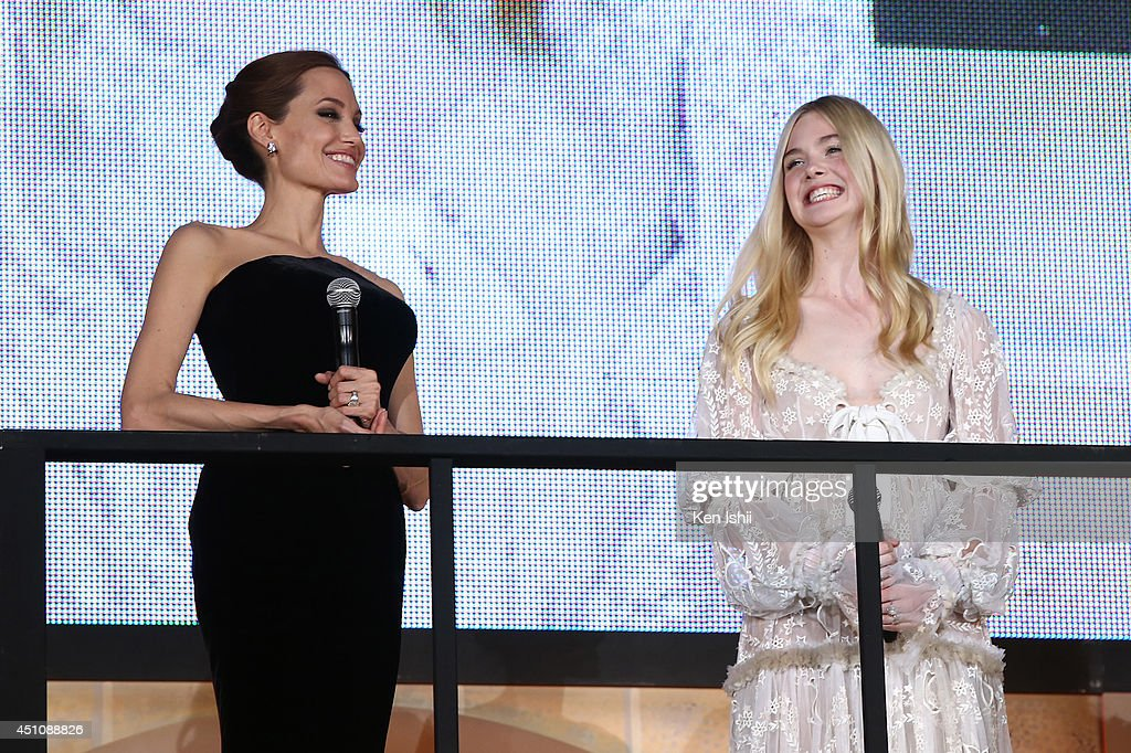Actress <a gi-track='captionPersonalityLinkClicked' href=/galleries/search?phrase=Angelina+Jolie&family=editorial&specificpeople=201591 ng-click='$event.stopPropagation()'>Angelina Jolie</a> and <a gi-track='captionPersonalityLinkClicked' href=/galleries/search?phrase=Elle+Fanning&family=editorial&specificpeople=2189940 ng-click='$event.stopPropagation()'>Elle Fanning</a> attend 'Maleficent' Japan premiere at Ebisu Garden Place on June 23, 2014 in Tokyo, Japan.