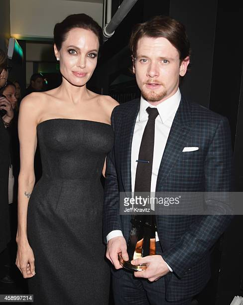 Actress Angelina Jolie and honoree Jack O'Connell pose backstage during the 18th Annual Hollywood Film Awards at The Palladium on November 14 2014 in...