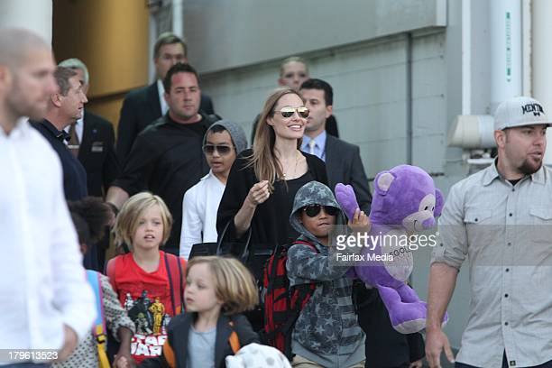 US actress Angelina Jolie arrives at Sydney Airport with her children on September 6 2013 in Sydney Australia