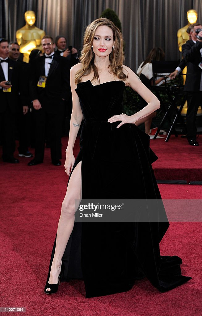 Actress <a gi-track='captionPersonalityLinkClicked' href=/galleries/search?phrase=Angelina+Jolie&family=editorial&specificpeople=201591 ng-click='$event.stopPropagation()'>Angelina Jolie</a> arrives at the 84th Annual Academy Awards at the Hollywood & Highland Center February 26, 2012 in Hollywood, California.