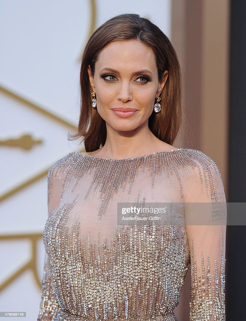 Actress Angelina Jolie arrives at the 86th Annual Academy Awards at Hollywood Highland Center on March 2 2014 in Hollywood California