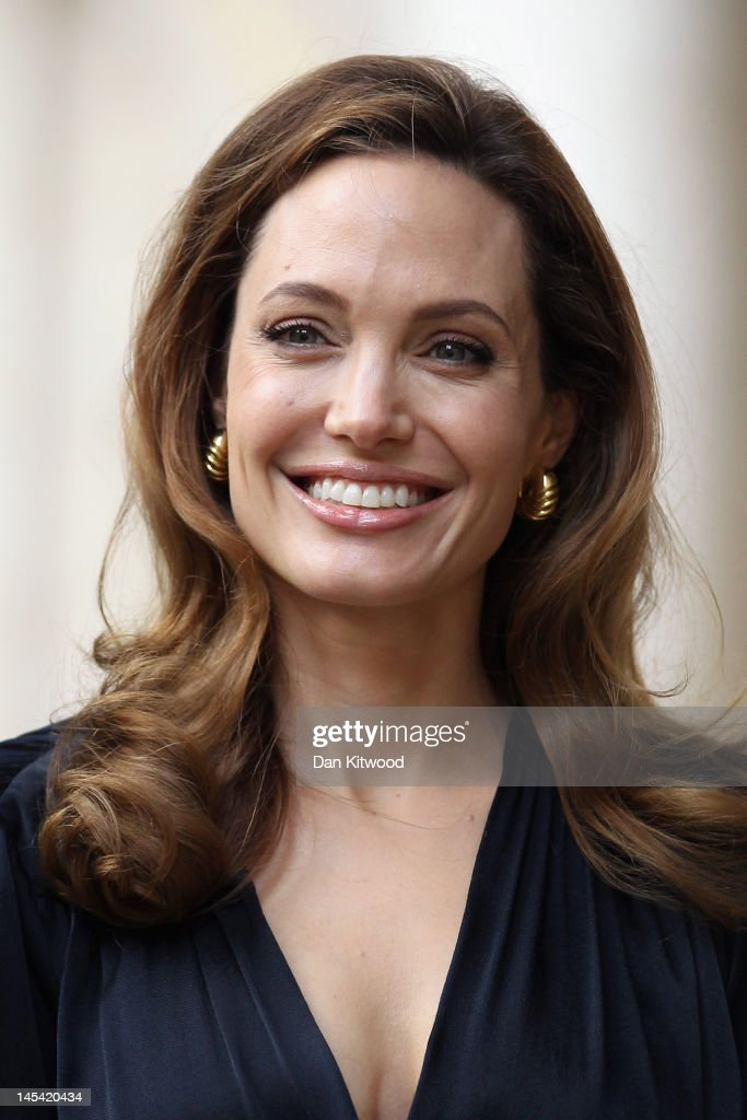 Actress <a gi-track='captionPersonalityLinkClicked' href=/galleries/search?phrase=Angelina+Jolie&family=editorial&specificpeople=201591 ng-click='$event.stopPropagation()'>Angelina Jolie</a> arrives to meet government ministers ahead of a screening of her new film 'In the Land of Blood and Honey' at the Foreign Commonwealth Office (FCO) on May 29, 2012 in London, England. <a gi-track='captionPersonalityLinkClicked' href=/galleries/search?phrase=Angelina+Jolie&family=editorial&specificpeople=201591 ng-click='$event.stopPropagation()'>Angelina Jolie</a> spoke on the Foreign Secretary's initiative on preventing sexual violence in Conflict, ahead of the screening.