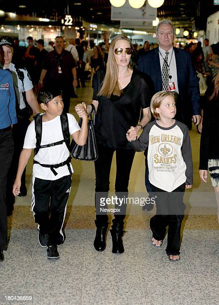 Actress Angelina Jolie arrives with children Pax JoliePitt and Shiloh JoliePitt at Brisbane Domestic Airport on September 12 2013 in Brisbane...