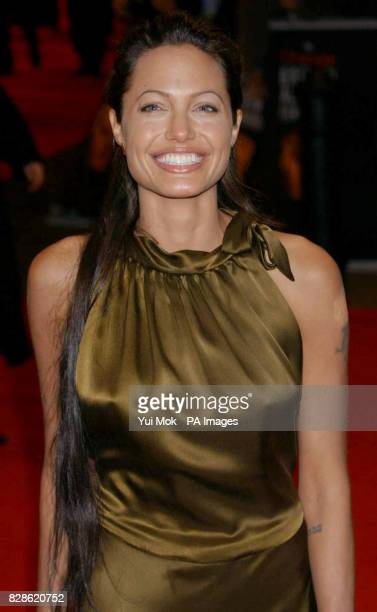 Actress Angelina Jolie arriving at the Odeon in Leicester Square London for The Orange British Academy Film Awards She is wearing a dress by Colette...