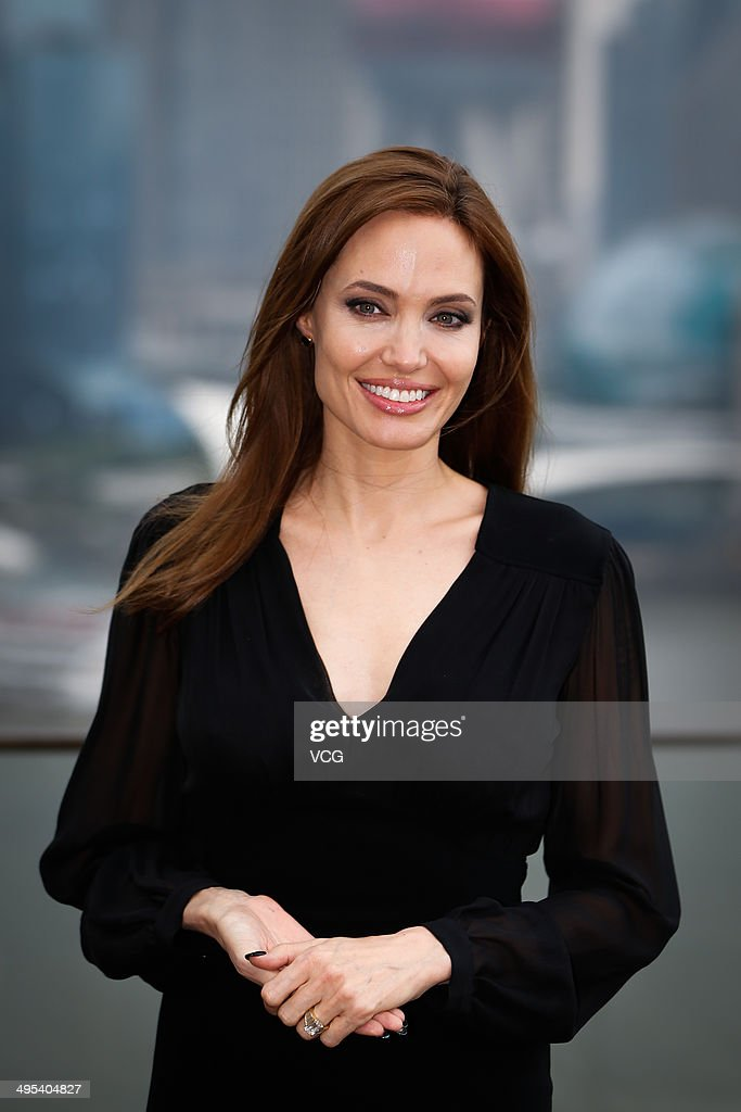 Actress <a gi-track='captionPersonalityLinkClicked' href=/galleries/search?phrase=Angelina+Jolie&family=editorial&specificpeople=201591 ng-click='$event.stopPropagation()'>Angelina Jolie</a> attends 'Maleficent' photocall at The Bund on June 3, 2014 in Shanghai, China.