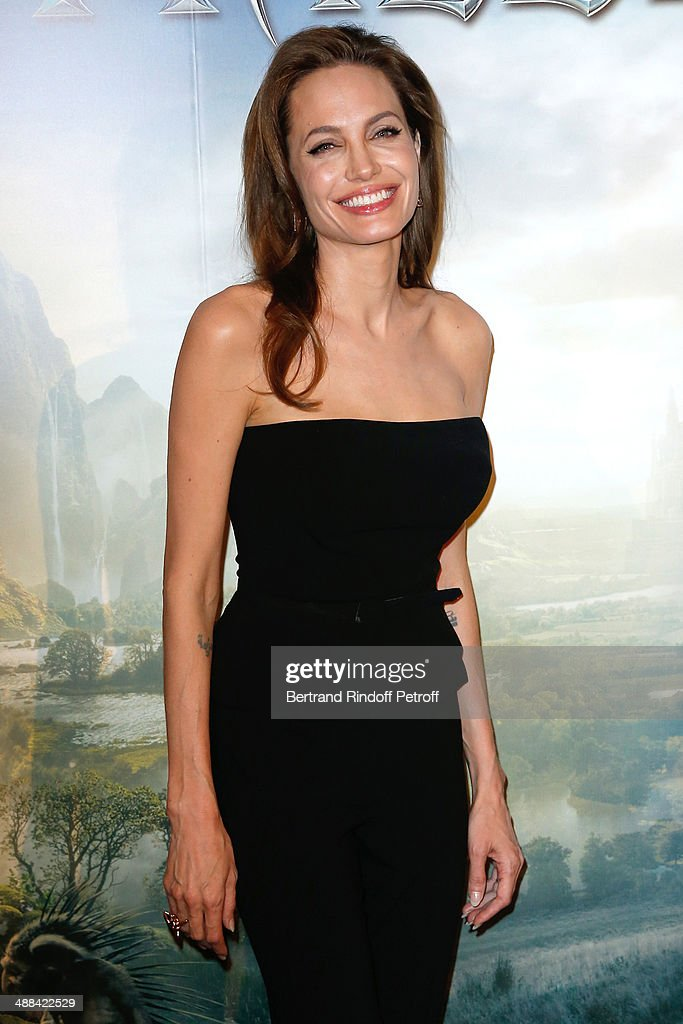 Actress Angelina Jolie (wearing outfit Ralph Lauren, earings Robert Procop) attends the 'Maleficent' Paris Photocall, held at Hotel Bristol on May 6, 2014 in Paris, France.