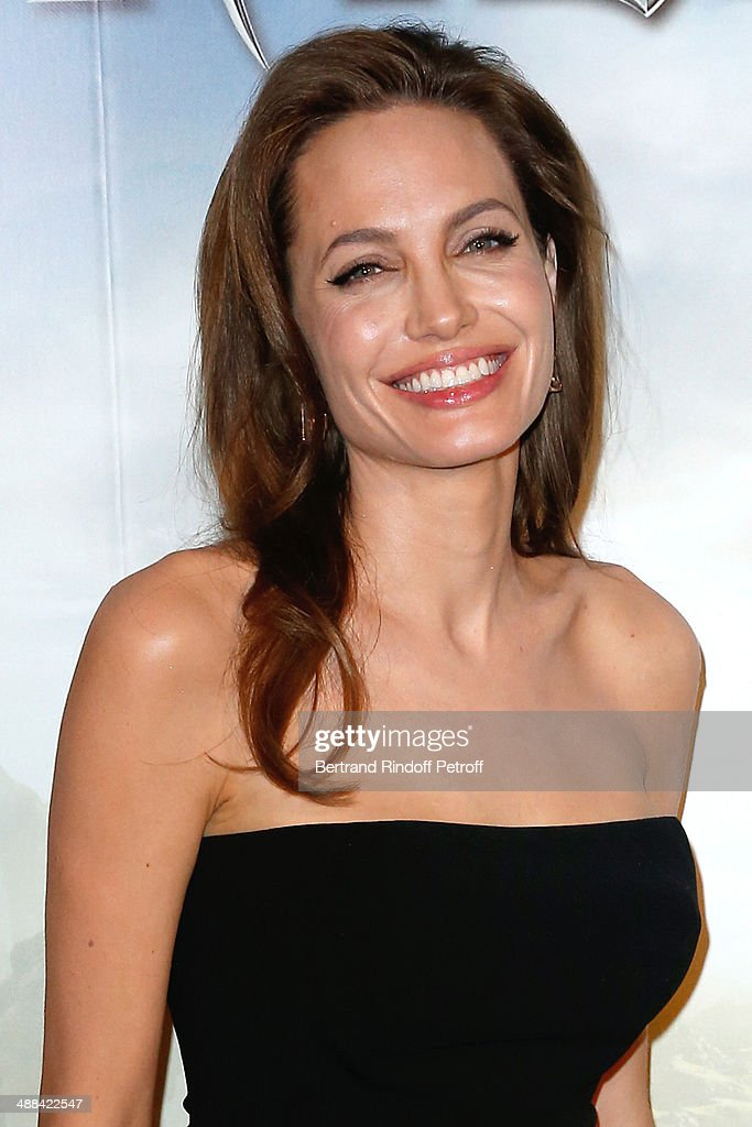 Actress Angelina Jolie (wearing earings Robert Procop) attends the 'Maleficent' Paris Photocall, held at Hotel Bristol on May 6, 2014 in Paris, France.