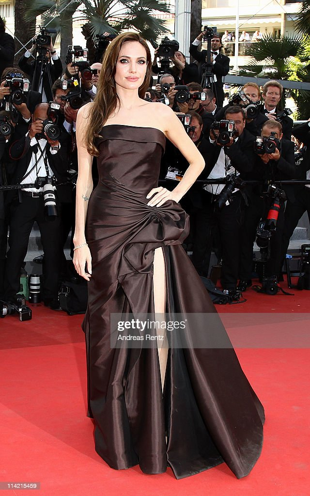 Actress <a gi-track='captionPersonalityLinkClicked' href=/galleries/search?phrase=Angelina+Jolie&family=editorial&specificpeople=201591 ng-click='$event.stopPropagation()'>Angelina Jolie</a> attends 'The Tree Of Life' premiere during the 64th Annual Cannes Film Festival at Palais des Festivals on May 16, 2011 in Cannes, France.