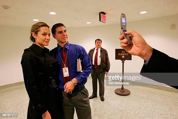 Actress Angelina Jolie has her photograph taken with a fan on Capitol Hill November 17 2005 in Washington DC Jolie was in Washington to help bring...
