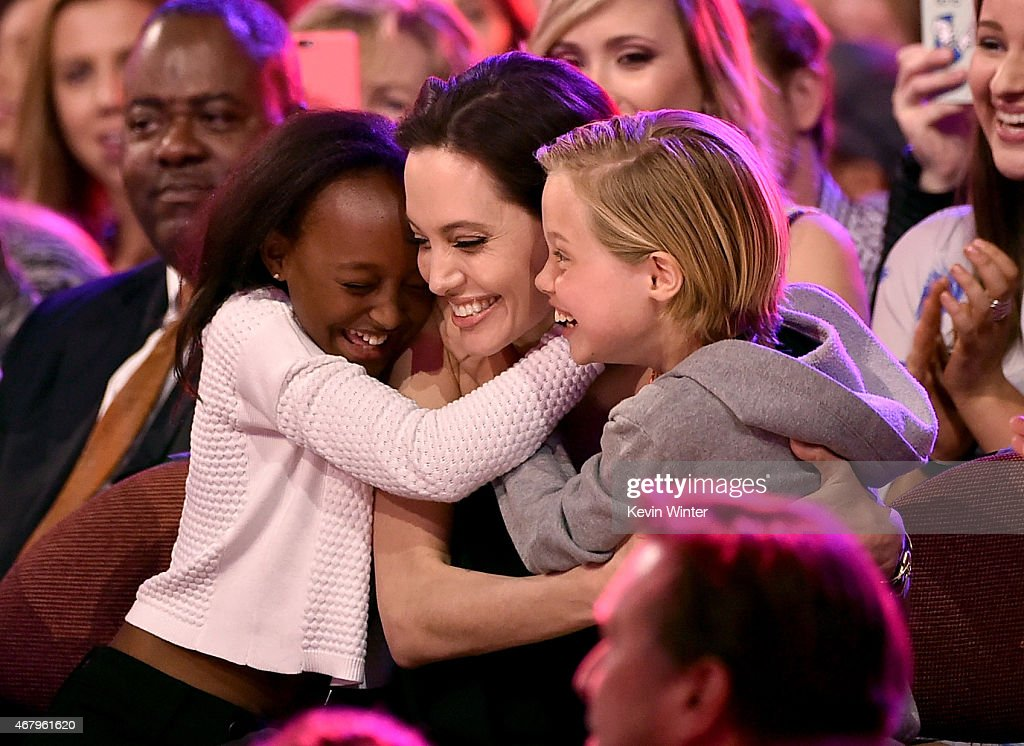 Actress Angelina Jolie hugs Zahara Marley JoliePitt and Shiloh Nouvel JoliePitt after winning award for Favorite Villain in 'Maleficent' during...
