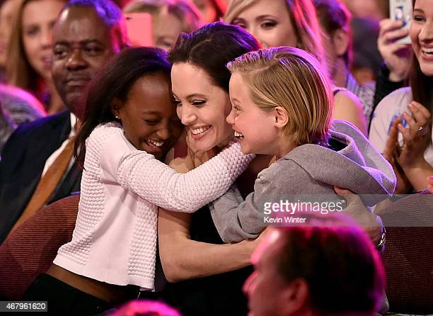 Actress Angelina Jolie hugs Zahara Marley JoliePitt and Shiloh Nouvel JoliePitt after winning award for Favorite Villain in 'Maleficent' during...