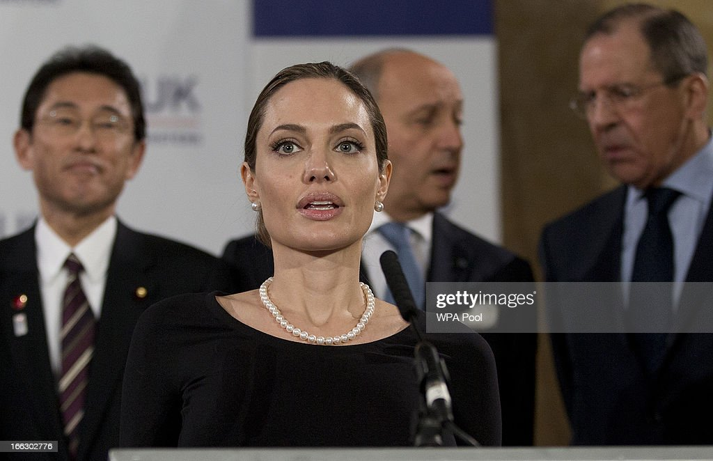 Actress <a gi-track='captionPersonalityLinkClicked' href=/galleries/search?phrase=Angelina+Jolie&family=editorial&specificpeople=201591 ng-click='$event.stopPropagation()'>Angelina Jolie</a>, in her role as UN envoy, talks during a news conference regarding sexual violence against women in conflict, at the Foreign Ministers G8 meeting in Lancaster House on April 11, 2013 in London, England. G8 Foreign Ministers are holding a two day meeting where they will discuss the situation in the Middle East, including Syria and Iran, security and stability across North and West Africa, Democratic People's Republic of Korea and climate change. British Foreign Secretary William Hague will also highlight five key policy priorities.