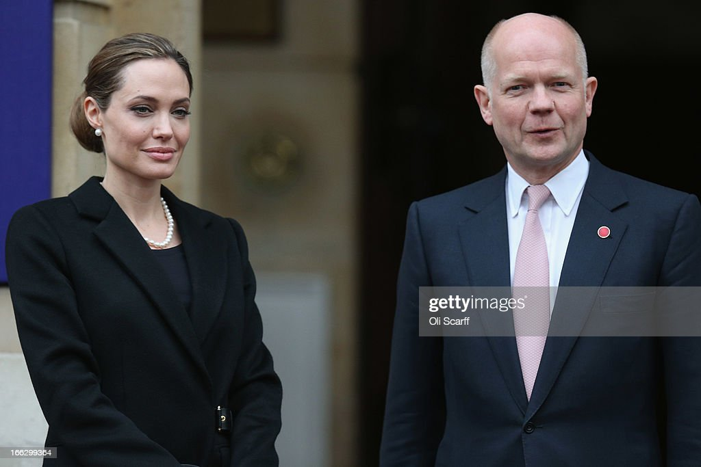 Actress <a gi-track='captionPersonalityLinkClicked' href=/galleries/search?phrase=Angelina+Jolie&family=editorial&specificpeople=201591 ng-click='$event.stopPropagation()'>Angelina Jolie</a> is greeted by British Foreign Secretary <a gi-track='captionPersonalityLinkClicked' href=/galleries/search?phrase=William+Hague&family=editorial&specificpeople=206295 ng-click='$event.stopPropagation()'>William Hague</a> at Lancaster House before attending the G8 Foreign Ministers' conference on April 11, 2013 in London, England. G8 Foreign Ministers are holding a two day meeting where they will discuss the situation in the Middle East; including Syria and Iran, security and stability across North and West Africa, Democratic People's Republic of Korea and climate change. British Foreign Secretary <a gi-track='captionPersonalityLinkClicked' href=/galleries/search?phrase=William+Hague&family=editorial&specificpeople=206295 ng-click='$event.stopPropagation()'>William Hague</a> will also highlight five key policy priorities.