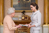 Actress Angelina Jolie is presented with the Insignia of an Honorary Dame Grand Cross of the Most Distinguished Order of St Michael and St George by...