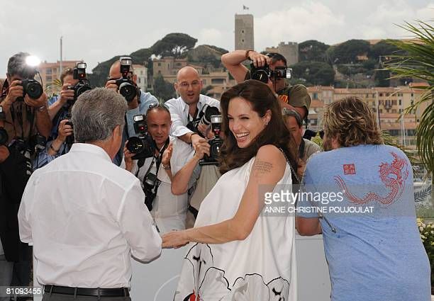 US actress Angelina Jolie laughs as she poses with fellow actors Dustin Hoffman and Jack Black during a photocall for US directors John Stevenson and...