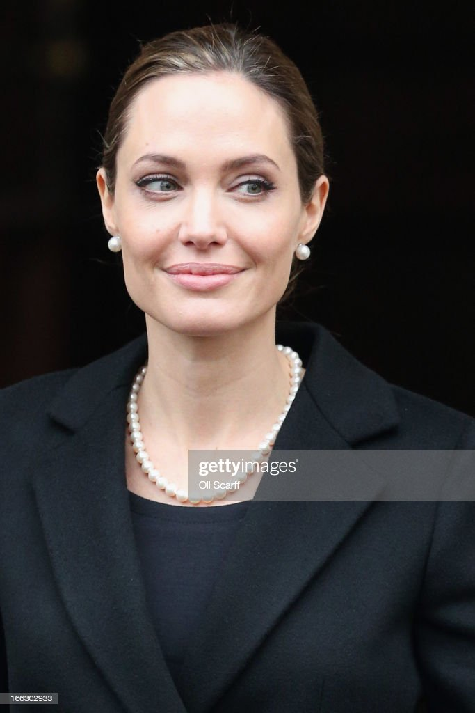 Actress <a gi-track='captionPersonalityLinkClicked' href=/galleries/search?phrase=Angelina+Jolie&family=editorial&specificpeople=201591 ng-click='$event.stopPropagation()'>Angelina Jolie</a> leaves Lancaster House after attending the G8 Foreign Minsters' conference on April 11, 2013 in London, England. G8 Foreign Ministers are holding a two day meeting where they will discuss the situation in the Middle East; including Syria and Iran, security and stability across North and West Africa, Democratic People's Republic of Korea and climate change. British Foreign Secretary William Hague will also highlight five key policy priorities.