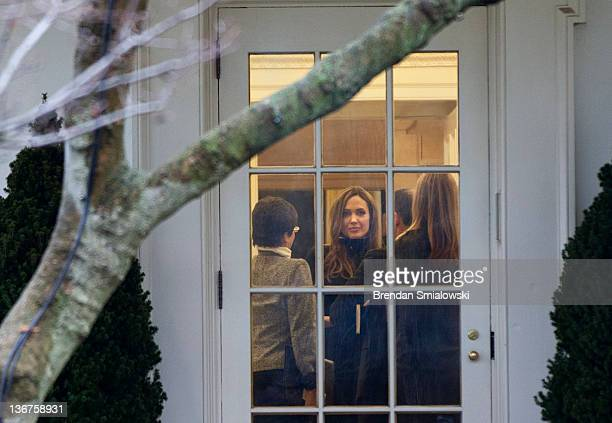 Actress Angelina Jolie looks out from the Oval Office of the White House after a meeting January 11 2012 in Washington DC Angelina Jolie was in...