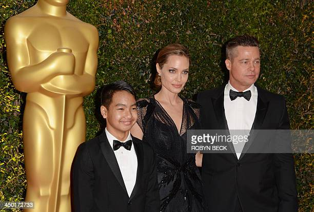 Actress Angelina Jolie Maddox JoliePitt and actor Brad Pitt arrive for the 2013 Governors Awards presented by the American Academy of Motion Picture...