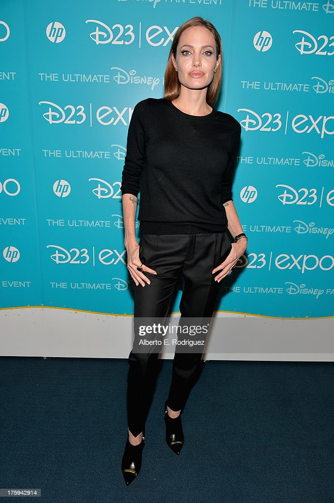 Actress <a gi-track='captionPersonalityLinkClicked' href=/galleries/search?phrase=Angelina+Jolie&family=editorial&specificpeople=201591 ng-click='$event.stopPropagation()'>Angelina Jolie</a> of 'Maleficent' attends 'Let the Adventures Begin: Live Action at The Walt Disney Studios' presentation at Disney's D23 Expo held at the Anaheim Convention Center on August 10, 2013 in Anaheim, California.