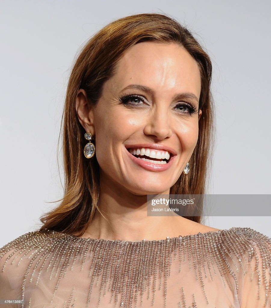 Actress Angelina Jolie poses in the press room at the 86th annual Academy Awards at Dolby Theatre on March 2, 2014 in Hollywood, California.