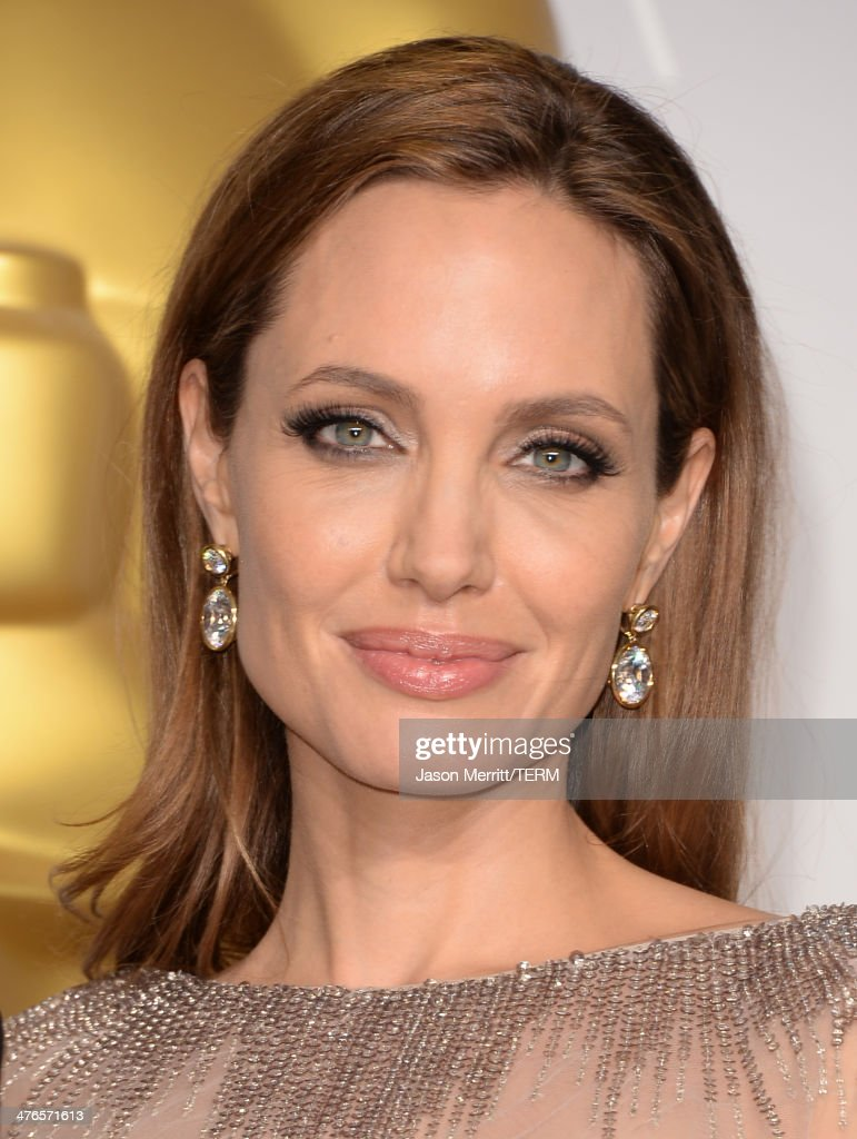 Actress Angelina Jolie poses in the press room during the Oscars at Loews Hollywood Hotel on March 2, 2014 in Hollywood, California.