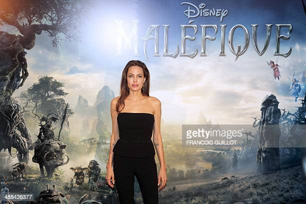 US actress Angelina Jolie poses on May 6 2014 in Paris for the press presentation of the new Disney movie 'Malefique' a new version of Sleeping...