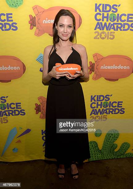 Actress Angelina Jolie poses with her Favorite Villain award backstage during Nickelodeon's 28th Annual Kids' Choice Awards held at The Forum on...