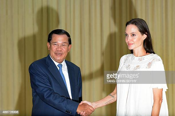 US actress Angelina Jolie shakes hands with Cambodian Prime Minister Hun Sen during a meeting at the Peace Palace in Phnom Penh on September 17 2015...