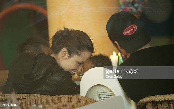 Actress Angelina Jolie snuggles with her adopted child Zahara while having lunch with boyfriend Brad Pitt and her other child Maddox February 4 2006...