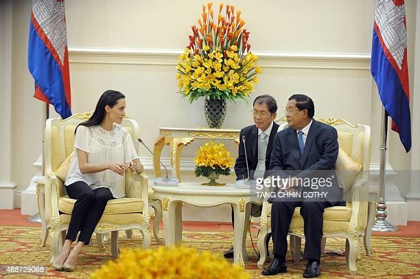 US actress Angelina Jolie speaks to Cambodian Prime Minister Hun Sen during a meeting at the Peace Palace in Phnom Penh on September 17 2015...