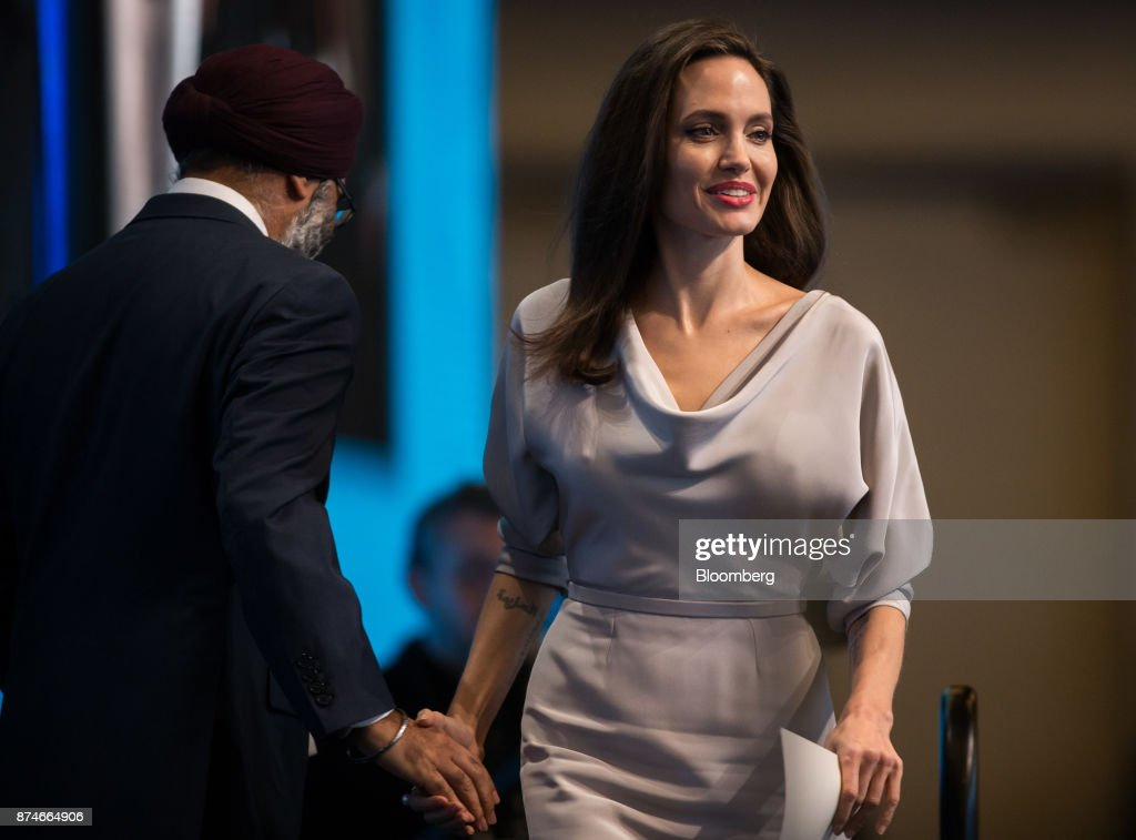 Actress Angelina Jolie, special envoy to the United Nations High Commissioner for Refugees, shakes hands with Harjit Sajjan, Canada's defense minister, before delivering a keynote speech during the 2017 UN Peacekeeping Defence Ministerial conference in Vancouver, British Columbia, Canada, on Wednesday, Nov. 15, 2017. Over 500 delegates from more than 70 countries and international organizations will gather at the upcoming Defence Ministerial to discuss improvements to UN peacekeeping operations and focus on securing new pledges from Member States. Photographer: Ben Nelms/Bloomberg via Getty Images