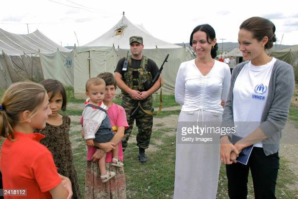 Actress Angelina Jolie talks with Chechen refugees in Bella refugee camp during her visit August 22 2003 in Ingushetia near the Chechen border in...