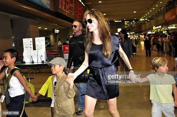 US actress Angelina Jolie walks with children Maddox Zahara Pax and Shiloh as she arrives at the Narita International Airport on July 26 2010 Jolie...