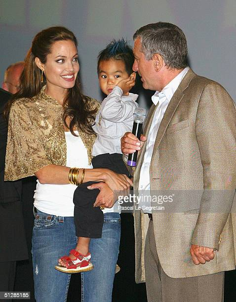 Actress Angelina Jolie with son Maddox and actor Robert De Niro at the World Premiere of 'Shark Tale' in San Marco Square as part of the 61st Venice...
