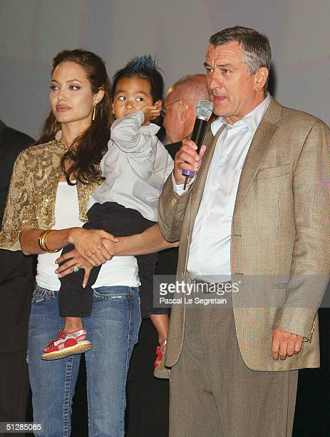 Actress Angelina Jolie with son Maddox and actor Robert De Niro attend the World Premiere of 'Shark Tale' in San Marco Square as part of the 61st...