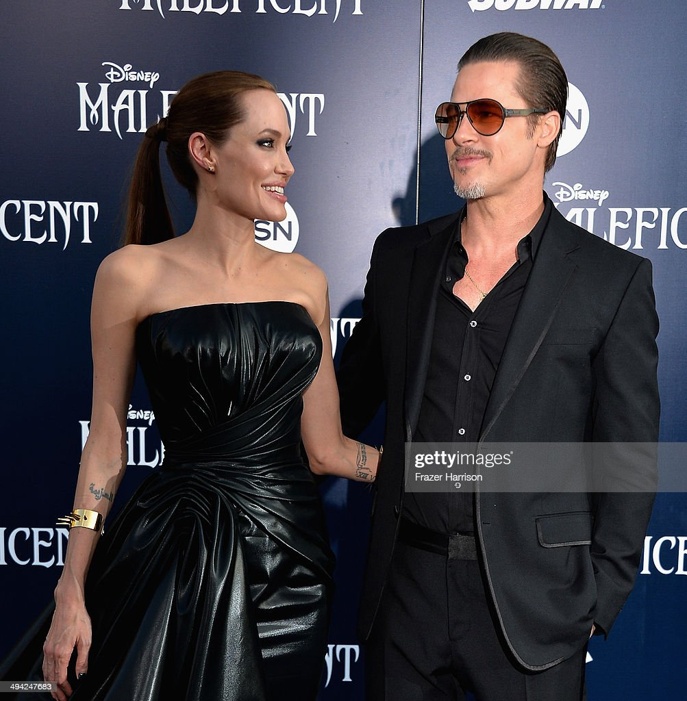 Actress <a gi-track='captionPersonalityLinkClicked' href=/galleries/search?phrase=Angelina+Jolie&family=editorial&specificpeople=201591 ng-click='$event.stopPropagation()'>Angelina Jolie</a>and <a gi-track='captionPersonalityLinkClicked' href=/galleries/search?phrase=Brad+Pitt+-+Actor&family=editorial&specificpeople=201682 ng-click='$event.stopPropagation()'>Brad Pitt</a> arrive at the World Premiere Of Disney's 'Maleficent' at the El Capitan Theatre on May 28, 2014 in Hollywood, California.