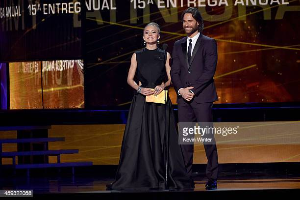 Actress Angelique Boyer and actor Sebastian Rulli speak onstage during the 15th annual Latin GRAMMY Awards at the MGM Grand Garden Arena on November...