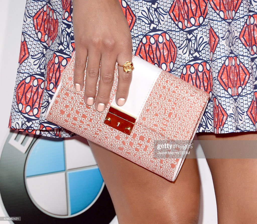 Actress Angelique Cabral (accessory detail) arrives at the Los Angeles premiere of 'Veronica Mars' at TCL Chinese Theatre on March 12, 2014 in Hollywood, California.