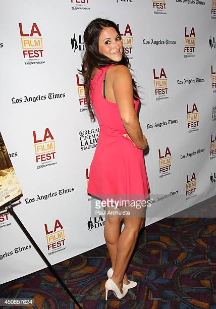 Actress Angelique Cabral attends the premiere of 'The Road Within' at the 2014 Los Angeles Film Festival at Regal Cinemas LA Live on June 18 2014 in...