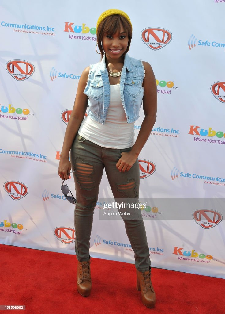 Actress Angell Conwell arrives at 'Family Day' hosted by Nick Cannon at Santa Monica Pier on October 6, 2012 in Santa Monica, California.