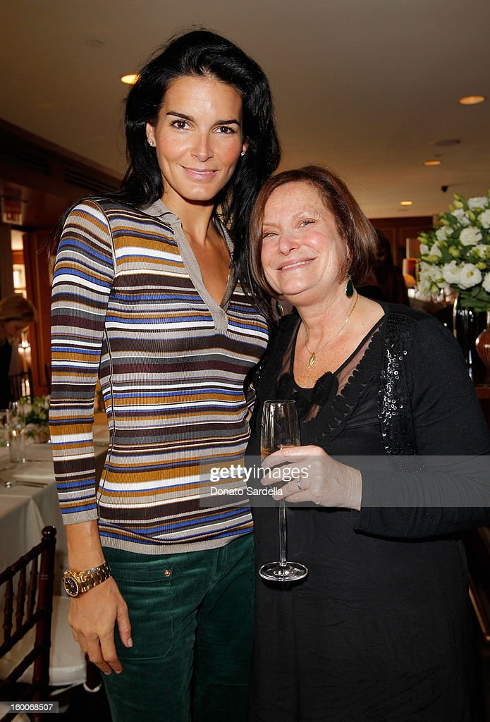 Actress Angie Harmon and host Cathy Sandrich Gelfond attend the Champagne Taittinger Women in Hollywood Lunch hosted by Vitalie Taittinger at Sunset Tower on January 25, 2013 in West Hollywood, California.