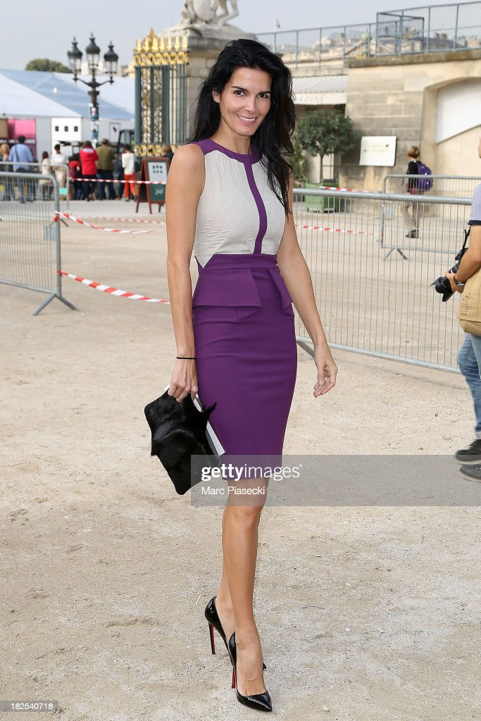 Actress <a gi-track='captionPersonalityLinkClicked' href=/galleries/search?phrase=Angie+Harmon&family=editorial&specificpeople=204576 ng-click='$event.stopPropagation()'>Angie Harmon</a> attends the Elie Saab show as part of the Paris Fashion Week Womenswear Spring/Summer 2014 on September 30, 2013 in Paris, France.